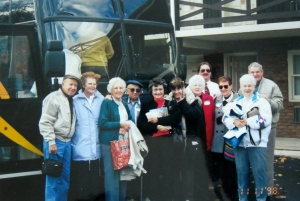 Grandma and a a group of her friends before a bus trip.